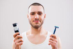 man holding razors