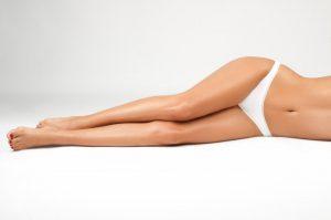 a woman laying down in a bikini bottom