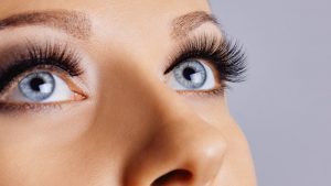 a woman with blue eyes and eyelash extensions